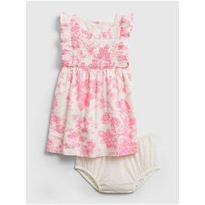 Ružové kvetinové šaty na gombíky vyobraziť